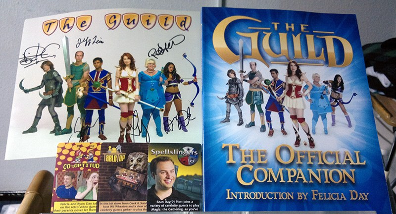 Picture of The Guild companion book and some other signed gifts