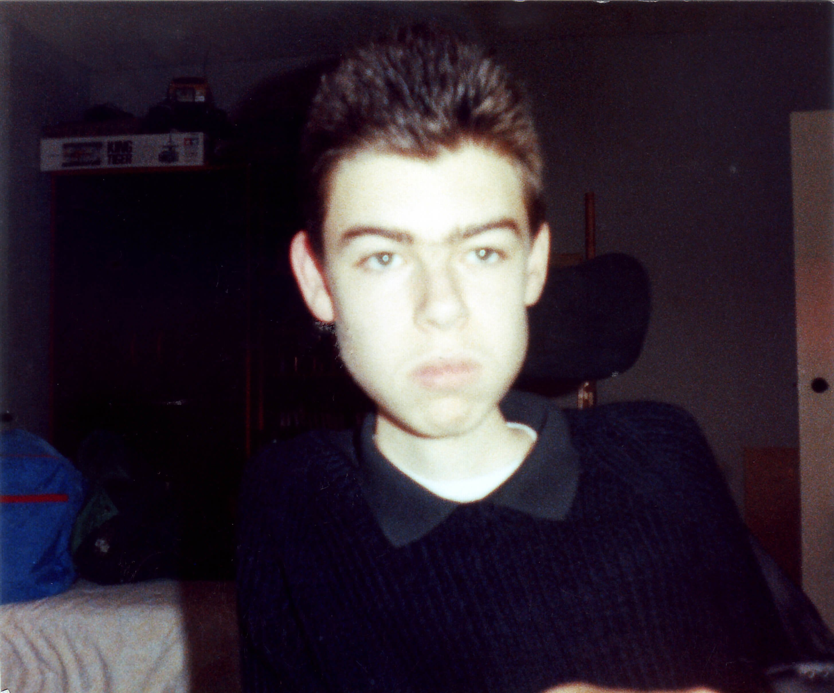 A picture of me, Daniel Baker, as a teenager in a black jumper
