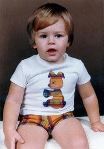 Me as a young boy wearing tartan shorts and a white T-shirt with a tartan bunny on the front