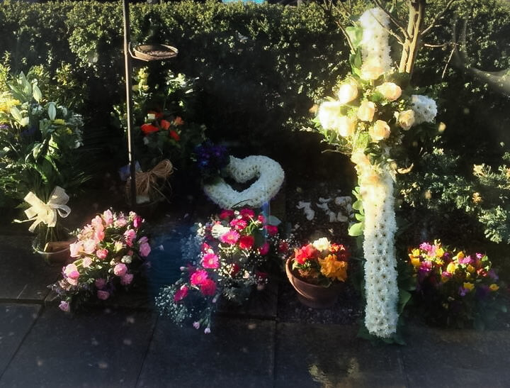 a selection of Funeral Flowers in the sun