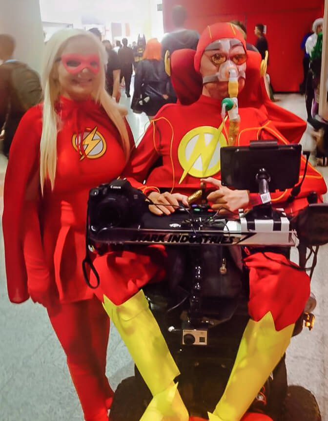 A picture of me in my wheelchair dressed as The Flash with a female Flash cosplayer