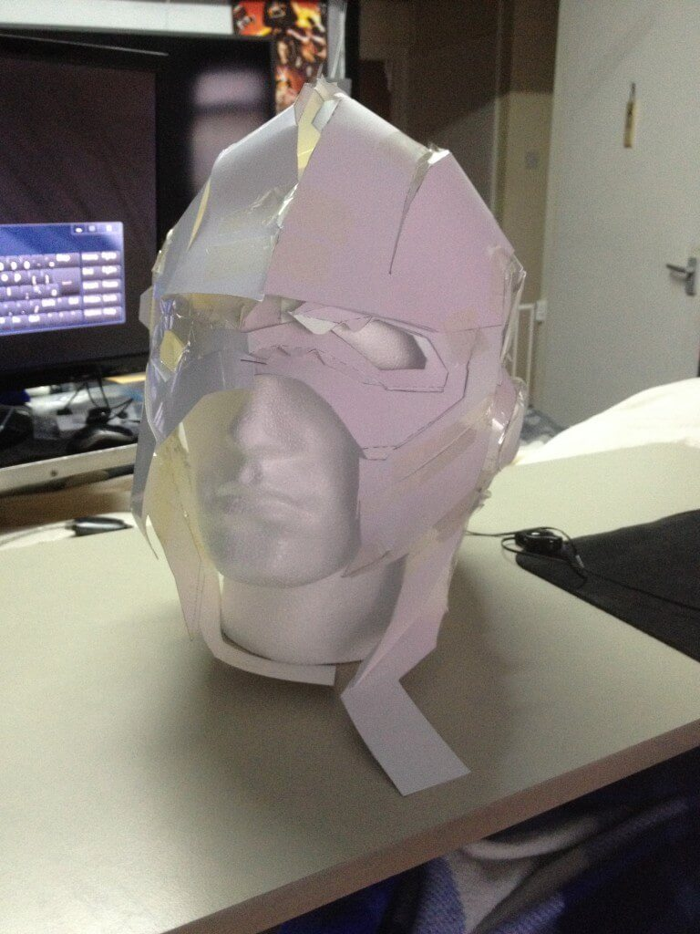 A cardboard Flash helmet on a polystyrene head