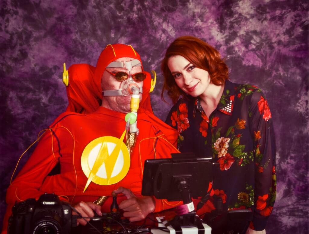 A picture of me in my wheelchair dressed as The Flash next to Felicia Day