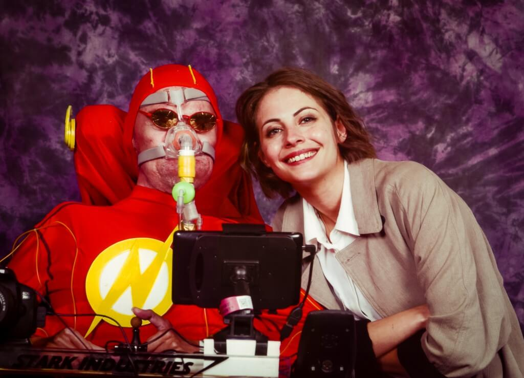 A picture of me in my wheelchair dressed as The Flash with Willa Holland