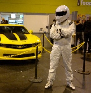 The Stig Standing next to Transformers Bumblebee in car form