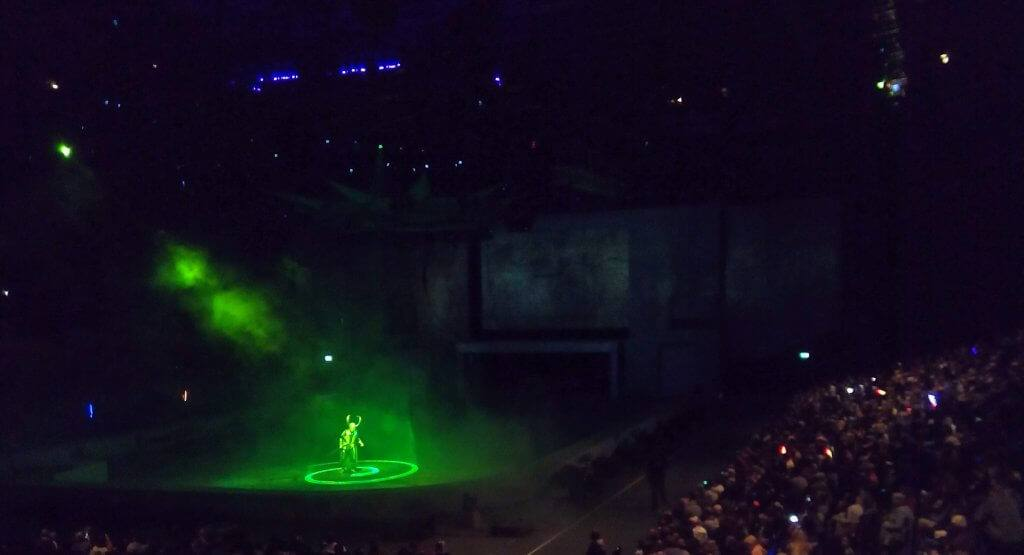 Loki on stage bathed in a green glow at Marvel Universe Live