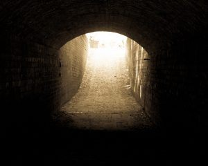Light at the end of the tunnel - Copyright 2016 Daniel Baker - a sepia brick tunnel with light at the end, taken at Hanbury Hall