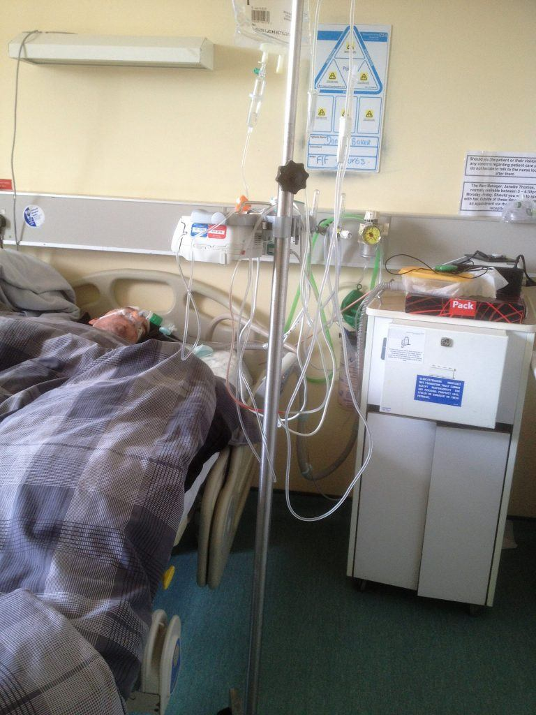 Daniel Baker laying in a hospital bed at Gloucester Royal Hospital