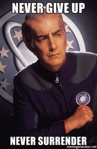 Picture of Alan Rickman in Galaxy quest with the text never give up, never surrender