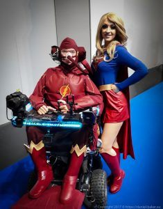 Daniel Baker dressed as The Flash with Tabitha Lyons standing next to him dressed as Supergirl at MCM Comiccon November 2017