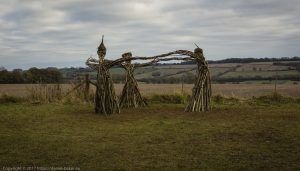 Wicker Witches standing in a circle in an English field