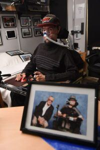 Daniel Baker in his bedroom with a picture of him and with Stan Lee in the foreground (Image: Kevin Fern Photography Ltd)