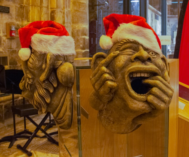 Gargoyles wearing Father Christmas hats at Gloucester Cathedral