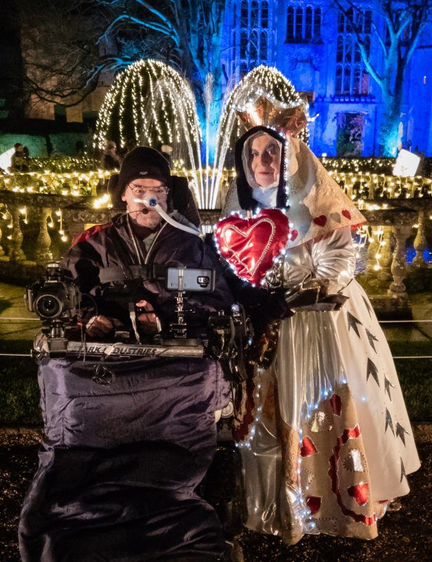 The Queen of Hearts posing for a photo with Daniel Baker at the Sudeley Castle Spectacle of Light