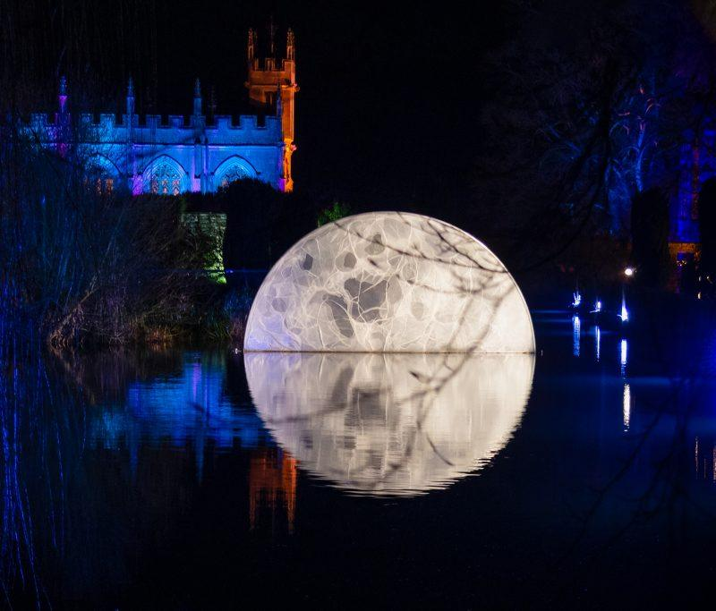 A illuminated moon floating in the water at the Sudeley Castle Spectacle of Light