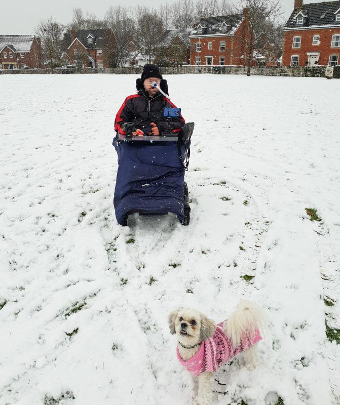 Daniel Baer in the snow with his dog Kara standing in front Snow February 1st 2019