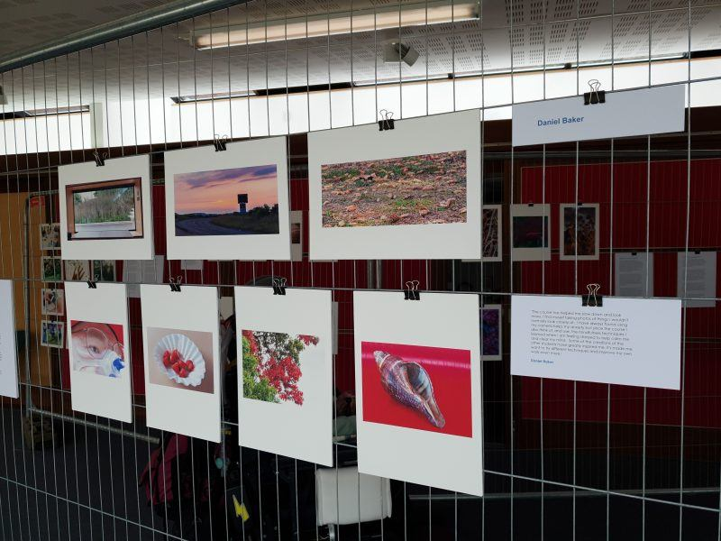 Daniel Baker's photographs on display at the mindful photography exhibition, there is a red theme to most pictures