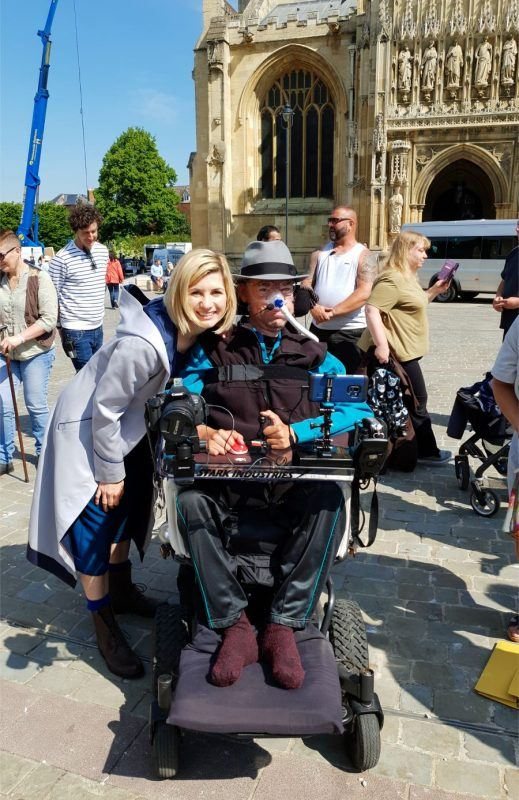 Dr Who Jodie Whittaker with Daniel Baker in front of Gloucester Cathedral