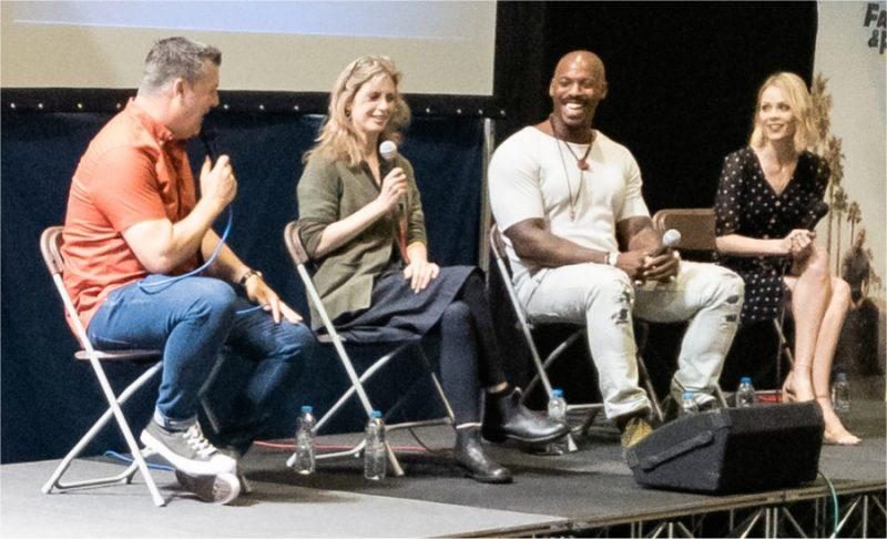 Helen Slater, Laura Vandervoort and Mehcad Brooks on stage at Collectormania 26