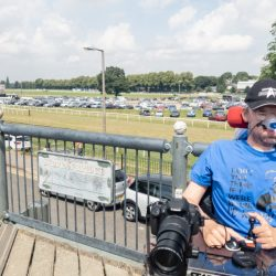"Daniel Baker sitting on a bridge overlooking Worcester raceecourse, wearing a blue big bang theory t-shirt which reads "" Don't you think if I was wrong I'd know it?"""