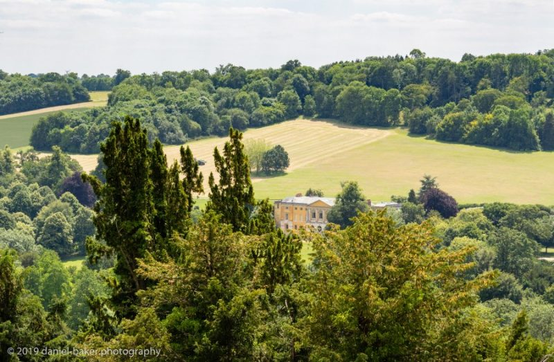View from the top of a hill looking down over West Wycombe park