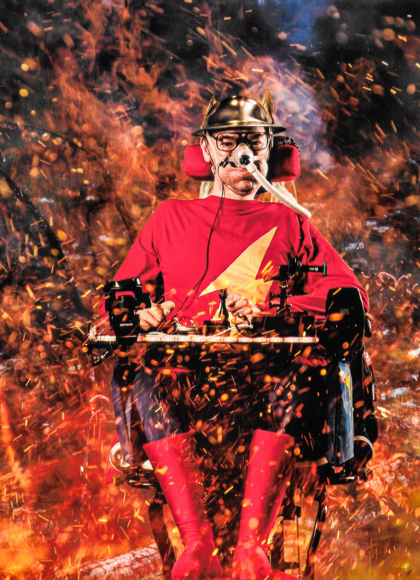Daniel Baker dressed as Jay Garrick The Flash surrounded by fire