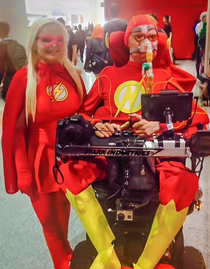 Daniel Baker dressed as the Flash with a female Flash cosplayer