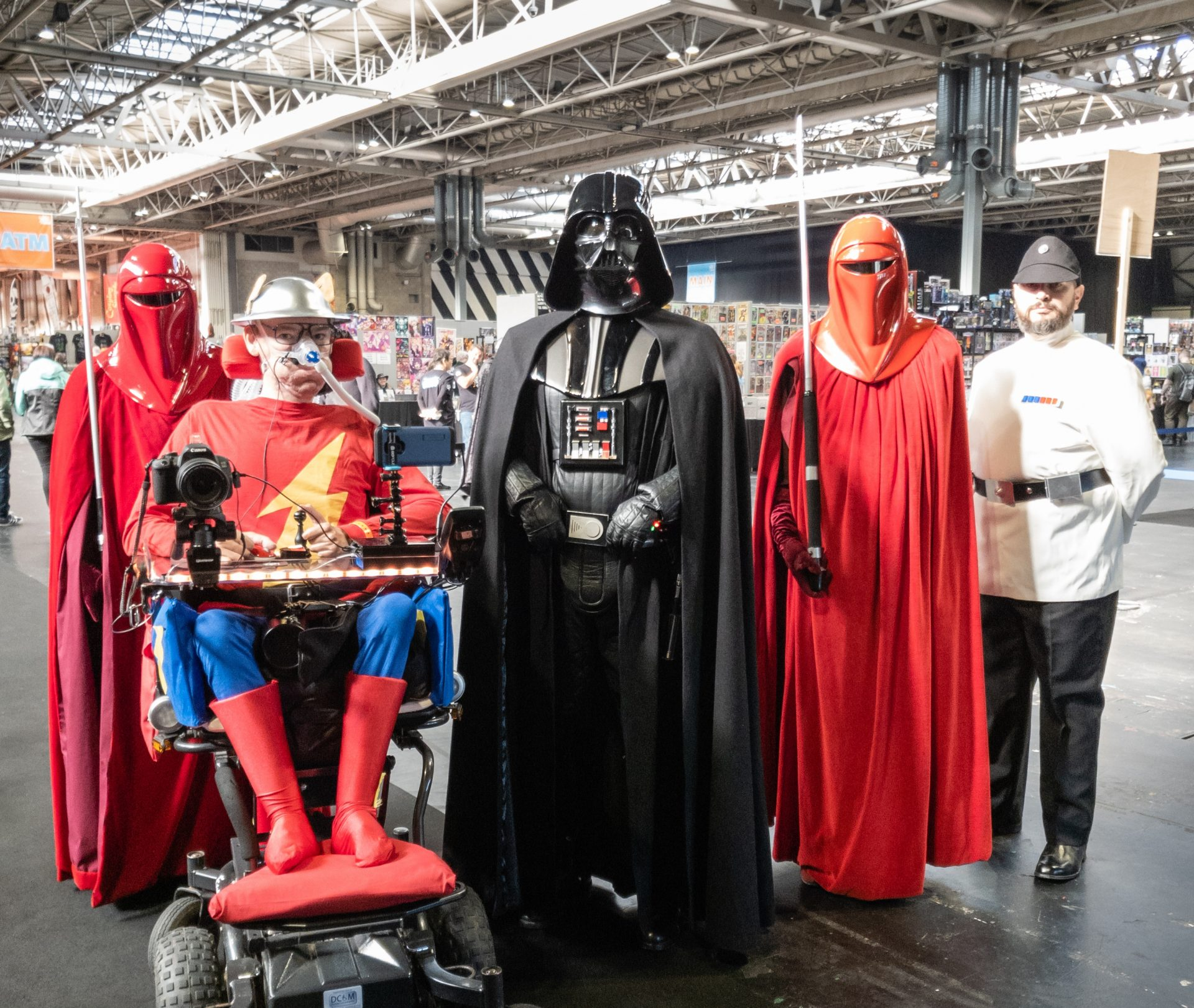 Daniel Baker dressed as Jay Garrick, The Flash Flanked by two imperial guards, Darth Vader and an Imperial commander
