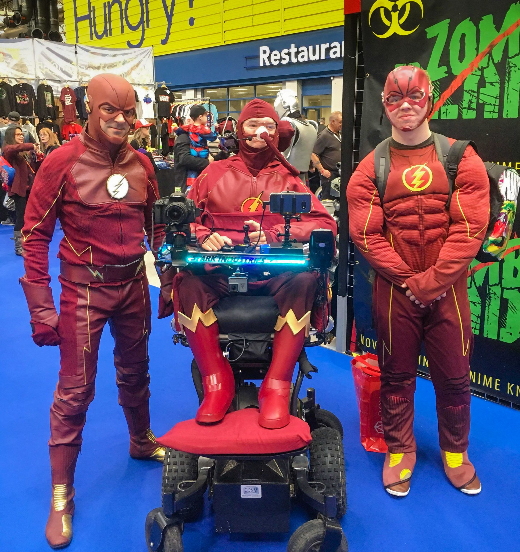 Daniel Baker dressed as the Flash with two other Flash cosplayers