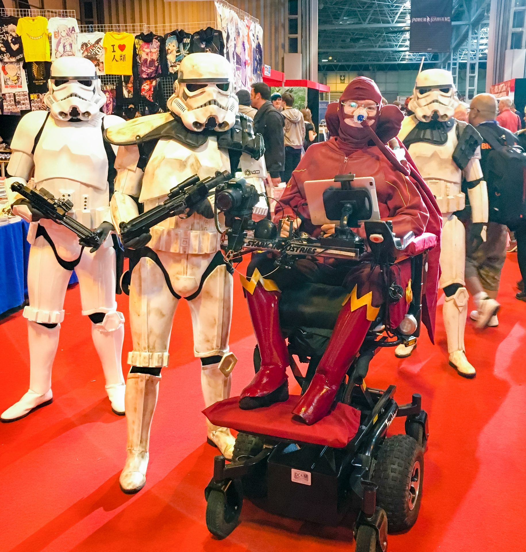 Daniel Baker dressed as The Flash with Stormtroopers around him