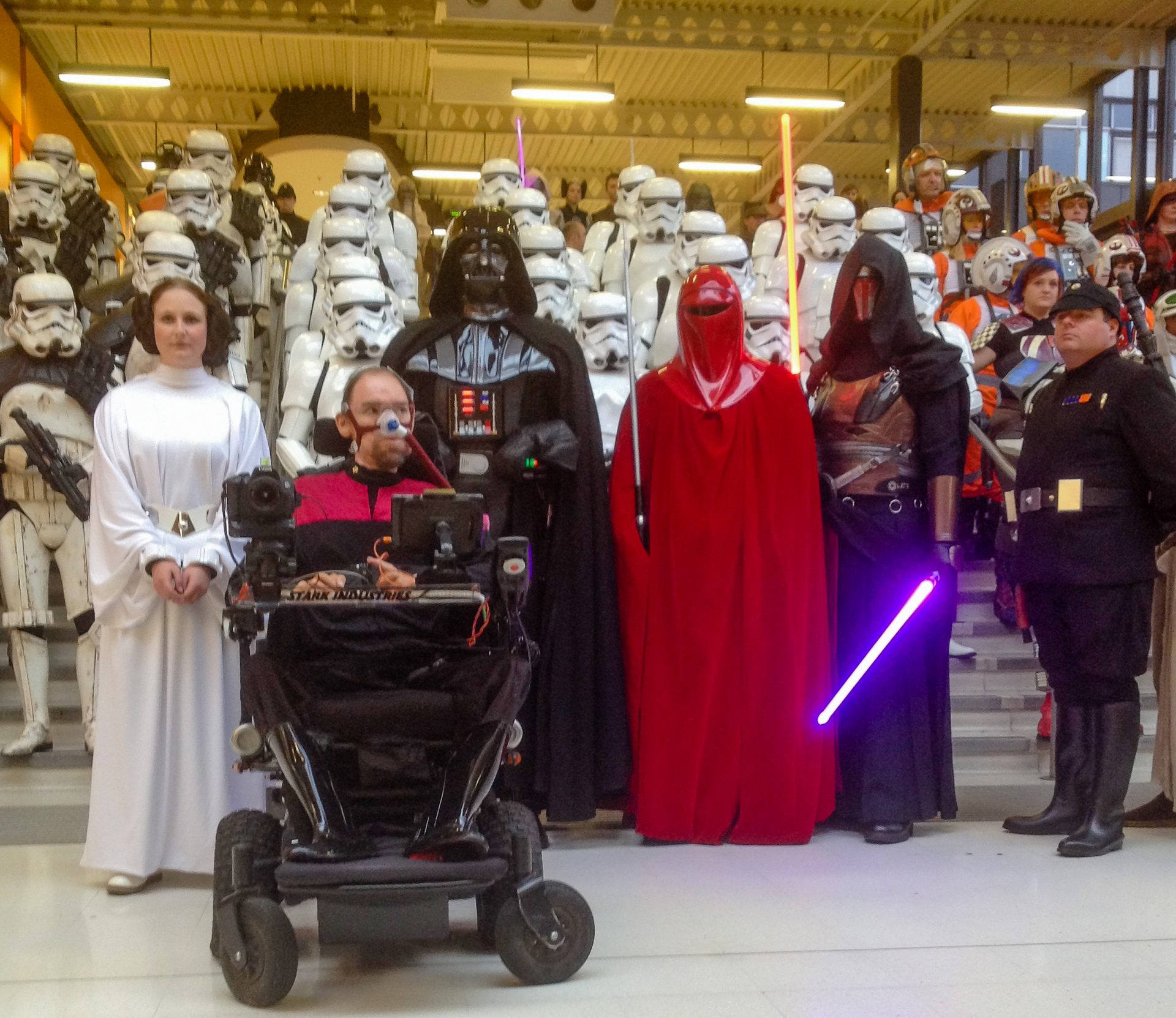 Daniel Baker in front of a battalion of Imperial troops with a handcuffed Princess Leia beside him, Daniel is dressed in a Star Trek uniform