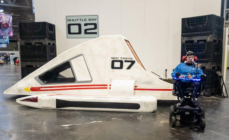 Daniel Baker dressed as Spock sitting next to a shuttle craft at Destination Star Trek 2019