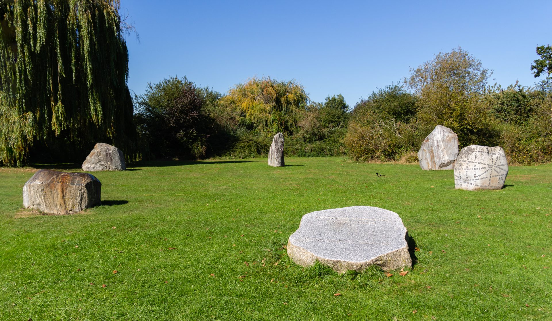 Modern standing stones with codes carved on them at Hesters way park behind GCHQ