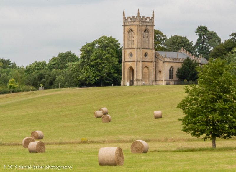 Church and hay bales at Croome