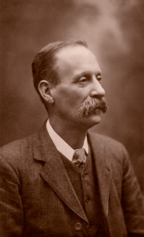 An old sepia photograph of a man with a large moustache