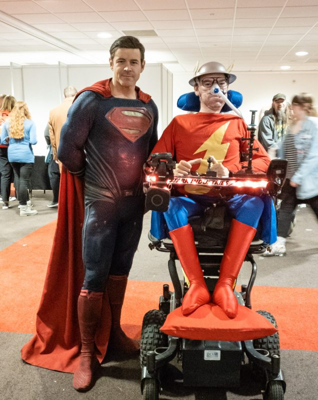 "Daniel Baker dressed as Jay Garrick ""The Flash"" with a Superman cosplayer standing next to him"