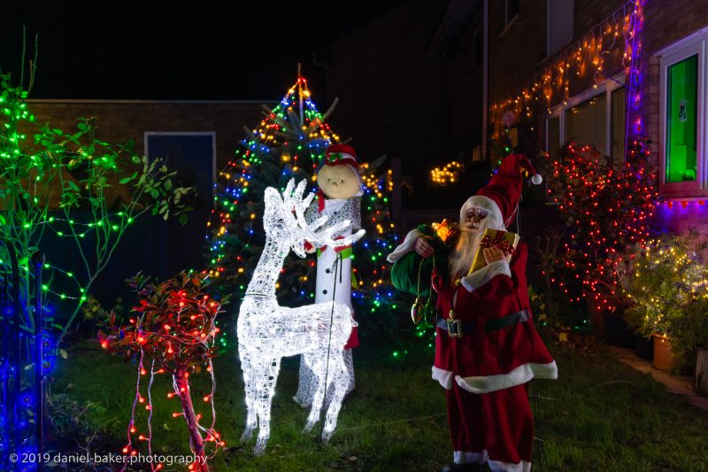 Illuminated Christmas decorations, including Father Christmas and a reindeer