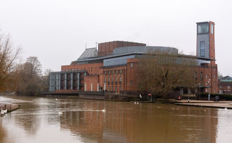 A view of the Royal Shakespeare Company Theatre from across the river Avon on A trip around the Cotswolds