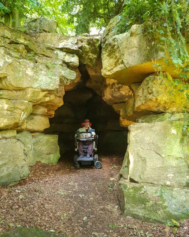 Daniel Baker inside a cave at Batsford Arboretum