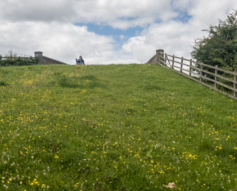 Looking up a steep hill towards a bridge