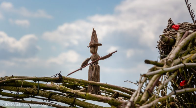close up of a small wicker witch perched on the wicker witches/faries at the Rollright stones