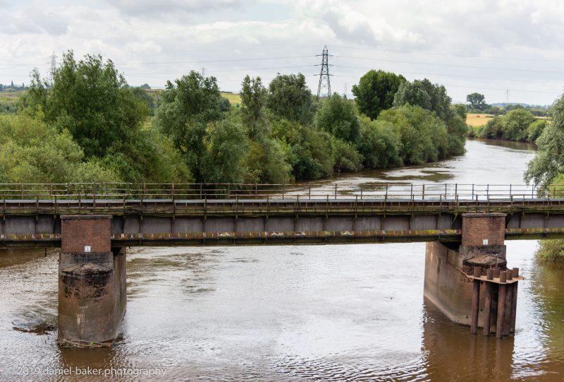 An old iron railway bridge over a canal