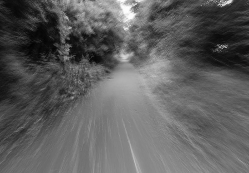 A blurred motion shot of a countryside path