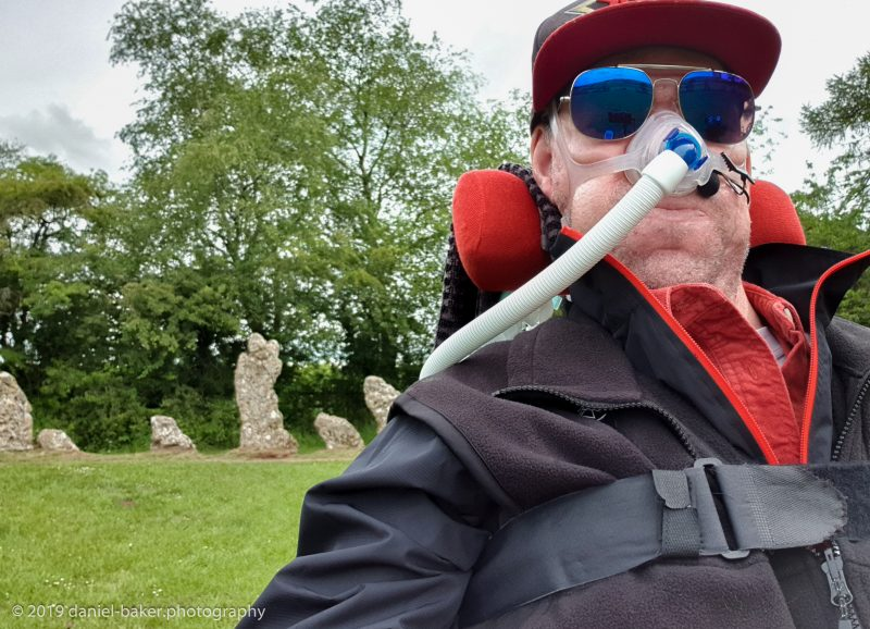 Daniel Baker sitting in front of the Rollright stones