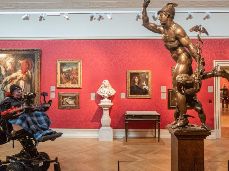 Daniel Baker looking at a statue of Mercury in the Ashmolean museum in Oxford