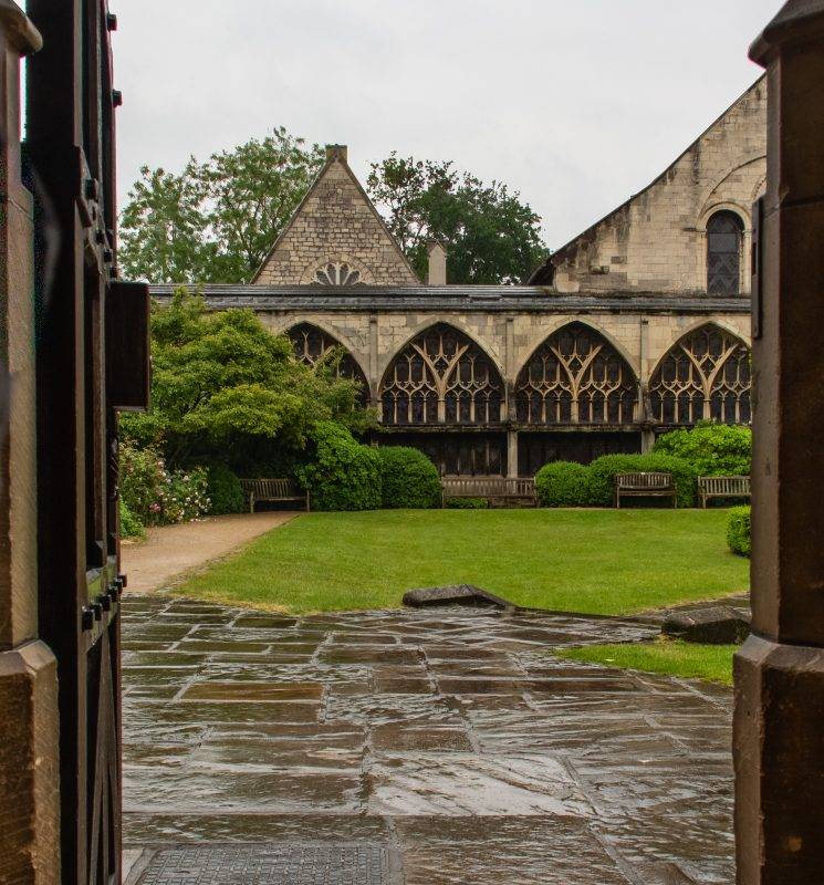 looking out into a rainy garden at Gloucester Cathedral