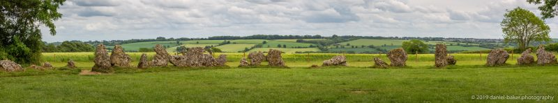 neolithic stone circle in a lush summer field at the rollrights