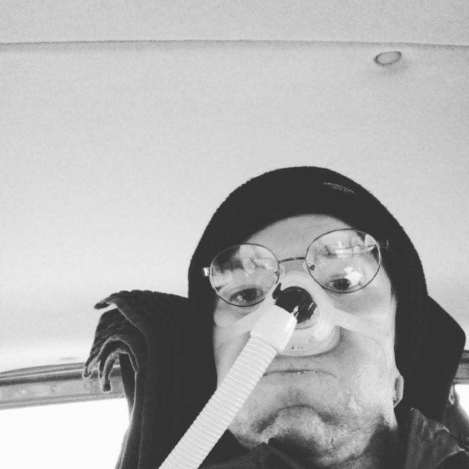 Black and white selfie of Daniel Baker looking panicked stuck in his van
