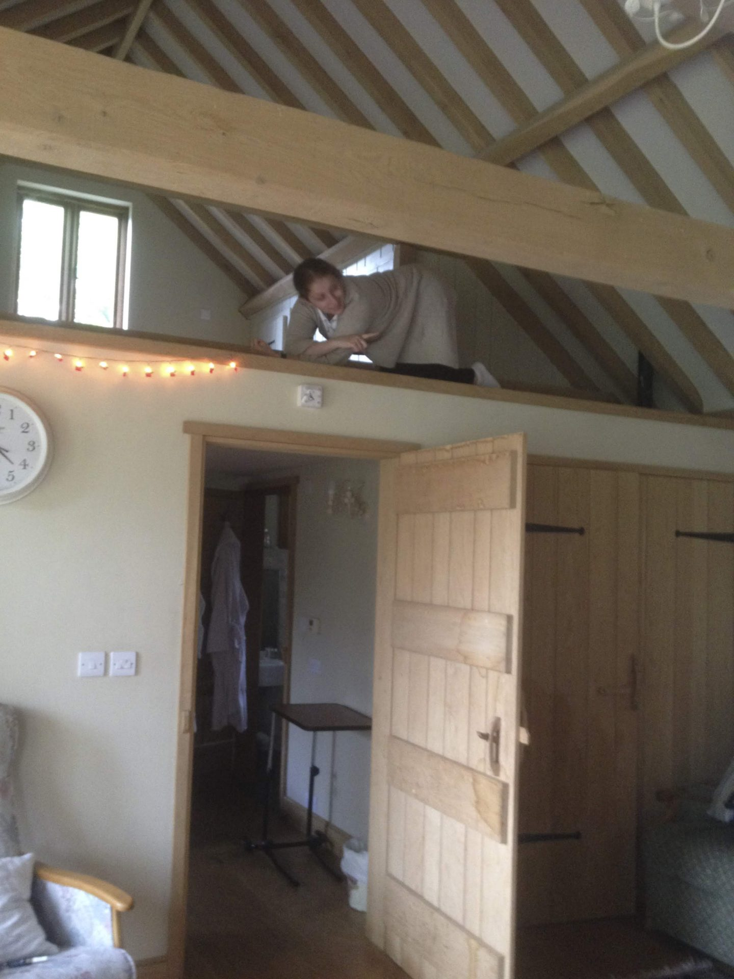Carer laying in the roof space of the barn