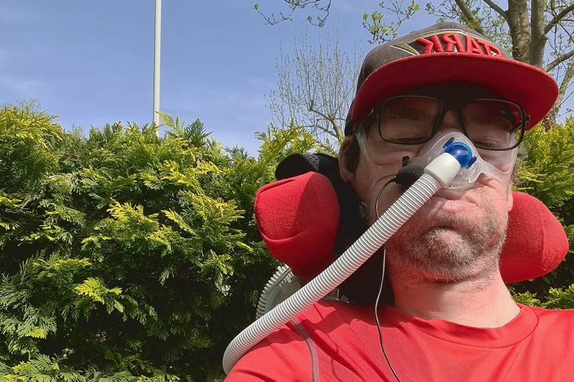 Newspaper article image of Daniel Baker in his front yard wearing a red baselayer and Stark Industries baseball cap - Newspaper and BMJ articles plus site updates